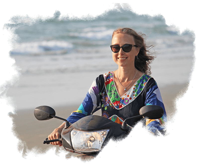 IMR Lady on beach using scooter